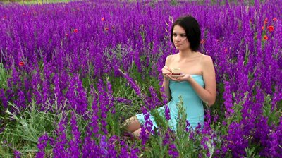 stock-footage-woman-drinking-tea-beautiful-girl-drinking-tea-in-nature-among-the-purple-flowers
